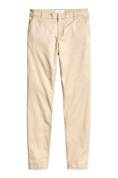 Chinos in washed, stretch cotton twill with a soft, brushed finish. Regular waist with a hook-and-eye fastener, side pockets, welt back pockets, a zip fly,