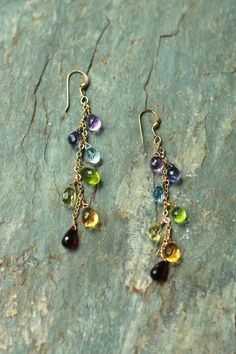 Radiate your inner beauty in these semi-precious chakra earrings that will ground you throughout the day.  Featured with garnet, citrine, lemon quartz, peridot, blue topaz, iolite, amethyst.  View and purchase at http://www.noelanidesigns.com/products/chakra