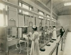 Manager, Mr. E.M. Bayliss and nurses attending babies in the Baby Incubator exhibit on the Pike at the 1904 World's Fair. ©Missouri History Museum