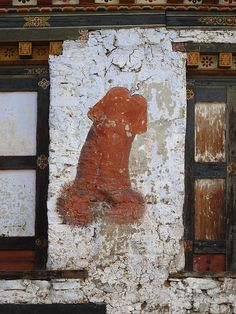 Phallus, painted on walls all across Bhutan are intended to to ward off evil spirits