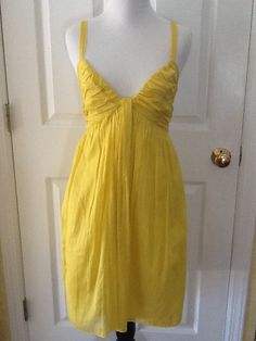 Prada Yellow Cotton V-neck Pleated Ruched Tank 44 Dress. Free shipping and guaranteed authenticity on Prada Yellow Cotton V-neck Pleated Ruched Tank 44 Dress at Tradesy. Prada Yellow V-neck Pleated Ruched Tank Dress 44 ...