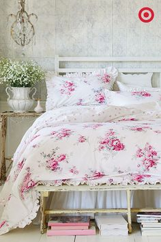 This rose bedding set from Simply Shabby Chic will have you dreaming of fragrant flower gardens. The elegant pattern is detailed with ruffled edges and a mini print on the opposite side—perfect for styling with fresh flowers and vintage furniture, like a rustic bench at the end of the bed.