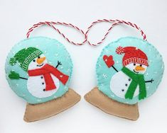 Handmade of soft felt, felt ornament, felt Christmas ornaments. This listing is for 2 felt snowglobe with snowman ornaments. Toys are totally hand made. Hand cut and hand sewn of high quality soft felt, lightly stuffed with non-allergenic hollofayber. Height - 4.3 (11.5 cm) Width - #feltornaments