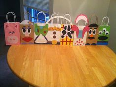 Toy story goodie bags: paper from hobby lobby, small bags from party city, no templet all free handed