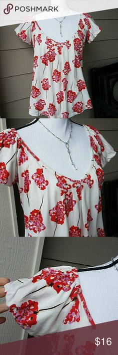 Anthropologie Porridge Floral V-Neck Top SZ Medium This shirt has been washed and worn but is still in fair condition. It has 3 small holes shown in Pic# 8 - also visible to the left of the measuring tape in Pic#6, Has Gathering/Darts around neckline, Has elastic above shoulders so can also be worn off the shoulders, Short/Cap sleeves, Colors: White /Red/Pink Anthropologie Tops Tees - Short Sleeve