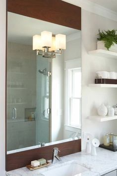 espresso stained wood framed vertical bathroom mirror, light gray painted single bathroom vanity with marble countertop, tan walls paint color and white floating shelves. Floating Shelves With Lights, Floating Shelf Under Tv, Floating Shelves Entertainment Center, Reclaimed Wood Floating Shelves, Floating Shelves Bedroom, Floating Shelves Kitchen, Rustic Floating Shelves, Bathroom Shelves, White Shelves