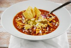 Checkout this hearty Crockpot Chicken Tortilla Soup Recipe at LaaLoosh.com! Slow simmered in a crockpot, each serving of this Weight Watchers soup is only 6 Points +.