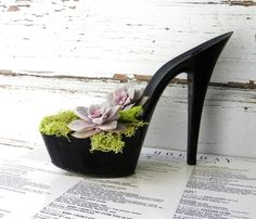 Floozy. Pure recycling at its best! Reclaimed black stiletto heel succulent planter. $55.00, via Etsy.
