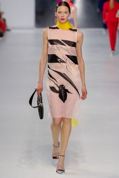 Christian Dior- a delicate shift dress with graphic punch and play with transparency