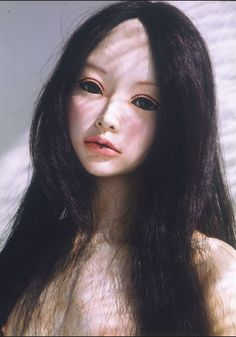 """Yoshiko Hori  doll.   Hori is one of the most famous Japanese sculptors. She created many realistic looking dolls. The dolls are called """"iki-ningyou"""" in Japanese, which means  lifelike dolls."""
