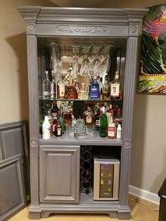 old TV entertainment center turned into a fun bar.