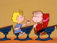 Believing that big heart-shaped box of chocolates is for her, Sally proudly presents her homemade valentine card to her disinterested crush Linus.