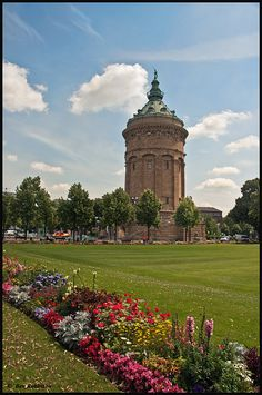 """Water Tower, Mannheim, Germany.  Mannheim is unusual among German cities in that its streets and avenues are laid out in a grid pattern, leading to its nickname """"die Quadratestadt"""" (""""city of the squares"""").  The civic symbol of Mannheim is der Wasserturm, a water tower just east of the city center."""
