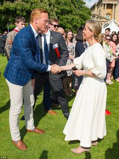 The Countess of Wessex was chic in a flowing cream dress and nude courts as she greeted Olympian Greg Rutherford