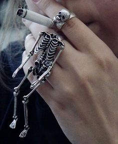 No for the cigarette, YES YES YES for the skeleton ring.