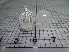 just a picture, but you get the idea... bird cage made using a gumball machine toy topper, by Chris P.