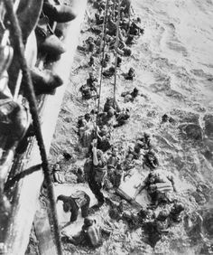 Survivors from the German battleship Bismarck, pulled out of the sea.