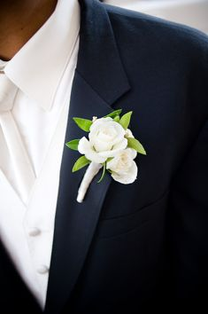 A simple white rose boutonniere  Photography by Nate Henderson Photography, Floral design by http://www.harveydesigns.com