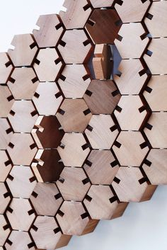 Wardrobe is made up of connected hexagonal wooden blocks, the units hang on your wall and when you need a place to hang your coat, scarf, or hat, you simply rotate one or more of the blocks to unveil a notch.