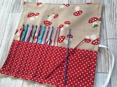 Items similar to Organiser pouch / storage roll / make up roll / crochet roll / pencil roll in red and cream on Etsy Shoe Storage Pallet, Built In Bathroom Storage, Wrapping Paper Storage, Ikea New, Crochet Hooks, Crochet Storage, Small Space Storage, Fabric Storage, Diy Crafts
