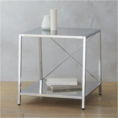 Shop harvey chrome nightstand.   Architectural X-brace construction in reflective chrome tapers two bed-roomy shelves.  Top's wide, bottom's even wider to stash a ton.  Great proportions.  Levelers included.  Also in carbon grey powdercoat.