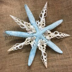 Have a seaside holiday! These hand made Christmas Tree Toppers are made of white sea stars, sliced white spindle shells, and sea urchin spines, and are jeweled Beach Christmas Trees, Nautical Christmas, How To Make Christmas Tree, Dollar Tree Christmas, Holiday Tree, Christmas Tree Toppers, Diy Christmas Ornaments, Christmas Tree Decorations, Christmas Ideas