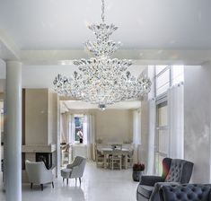 Schonbek Lighting Presents the Trilliane Collection's Crystal Chandelier with a Silver finish. This Innovative design Suggests the natural Growth of Mi Chandelier, Crystal Chandelier, Inspiration, Chandelier Style, Home, Light, Innovation Design, Home Decor