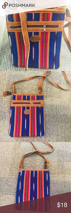 Guatemalan cross body purse. Blue color. Handmade This is a colorful blue crossbody purse. Handmade from Mayans in Guatemala. Imported. Brand new without tags. My Little Mayan Shop Bags Crossbody Bags