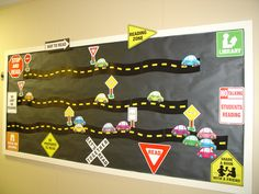 i gave each student a car and used road signs for reading counts points as a motivational board to track quarterly points