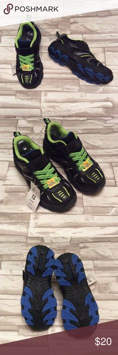 """BOYS Light Up Sneakers size 13 Brand new with tags, boys size 13 light up sneakers. The outside part of the toe lights up green when you walk. S Sport is the brand. Velcro and elastic closures. """"City Lightz"""" is the style name. The insole measures 8"""" long on the inside. S Sport Shoes Sneakers"""