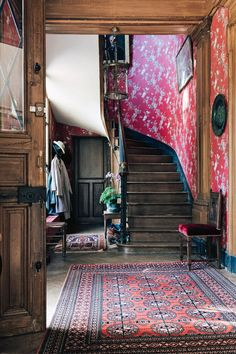 The entrance hall. Through the door on the left you'll find the petit salon - a cosy, casual room off the kitchen where the family eats breakfast. Behind us is the door into the grand salon and to the right is the formal dining room. Hand Painted Wallpaper, Painting Wallpaper, French Chateau Homes, Wood Floor Pattern, Decoration Entree, French Castles, Entry Hallway, Entrance Hall, Ivy House