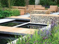 Outdoor Patio With Modular Ponds, Wooden Walkways, Modern Furniture