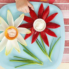 Guests can play she loves me/she loves me know when pulling a veggie petal to eat. Place small bowls of ranch or Thousand Island in the center for dipping. #produceforkids