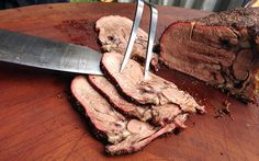 Sliced beef tongue by Adam Perry Lang with his meatchete