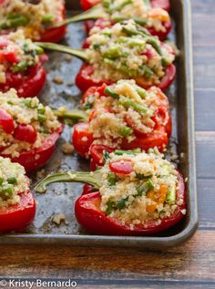 peppers stuffed with lemon quinoa, asparagus, cherry tomatoes & a hidden goat cheese surprise! Good for you and really delicious!