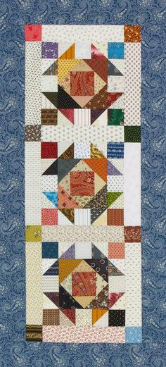 Color option made by Jody Sanders. Original quilt was Something Blue by designer Annette Plog made with blue and white reproduction prints. American Patchwork & Quilting June 2017.