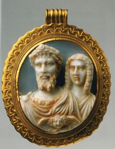 Roman cameo busts of emperor Septimius Severus and Julia Domna. bject dated to early II century CE. Made of sardonyx and gold. [536x699]