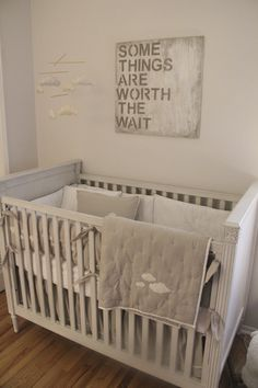 "A calm and serene nursery for our little boy inspired by the soft clouds crib bedding. We went with light, airy colors and stayed away from a ""theme."""