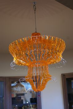 chandelier at  the SF Exploritorium made from plastic hangers