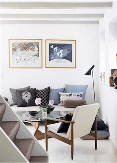 Nice sitting area, could be a concept for small nook area or library. I like the lamp. via decor8blog