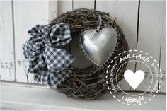 krans met grijze ruiten strik met zilver hart