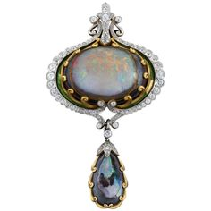 An American Art Nouveau 18 karat gold and platinum brooch/pendant with black opal, diamonds and enamel by Marcus Co. The brooch/pendant has a center cabochon opal and 76 old mine-cut diamonds with an approximate total weight of carats. Opal Jewelry, Jewelry Art, Antique Jewelry, Vintage Jewelry, Fine Jewelry, Jewelry Design, Fashion Jewelry, Jewellery, Fashion Accessories
