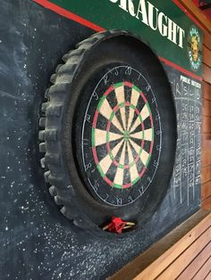 Motocross Tire Dart Board On A Chalk Board For Keeping Score (photo only) Dartboard Setup, Motocross Bedroom, Casa Mix, Diana, Tire Furniture, Game Room Bar, Man Shed, Tyre Shop, Old Tires