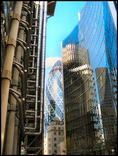 Lloyds HQ, The Gherkin and Willis reflections, London, by garethr1 on Flickr, 2009.