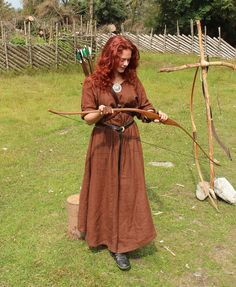 A Norwegian girl working as a Viking Archery Instructor.