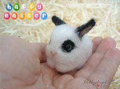 Needle felted Bunny Easter bunny Needle felted animal Needle felted Bunny White and black bunny Easter bunny doll Bunny felt Gift easter This little cute bunny was born today. He has an interesting white color around the eyes, ears and part of the tail is black.   hypoallergenic natural wool, merino wool, glass eyes.  Made with dry needle felting and hand, completely handmade. I take inspiration from seeing the image of beautiful live animals. I try as much as possible to work in another way…