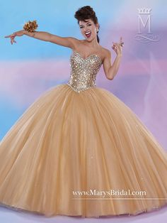 This gold ballgown is a showstopper with a fully beaded bodice and lace up back.