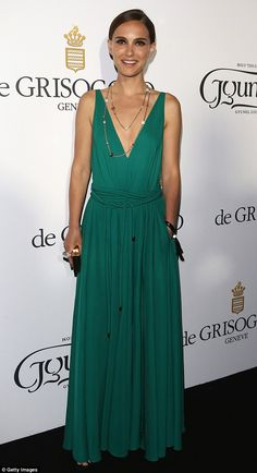 Taking the plunge: Natalie Portman went for understated sexiness in a low-cut green maxi d...