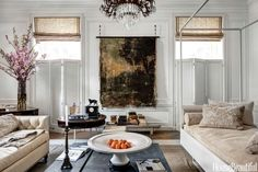 The white wall acts as a frame for the canvas wall hanging.   3 Playlists That Energize a Room's Decor  - HouseBeautiful.com