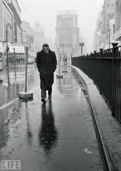 James Dean walks through Times Square (Photo by Dennis Stock)